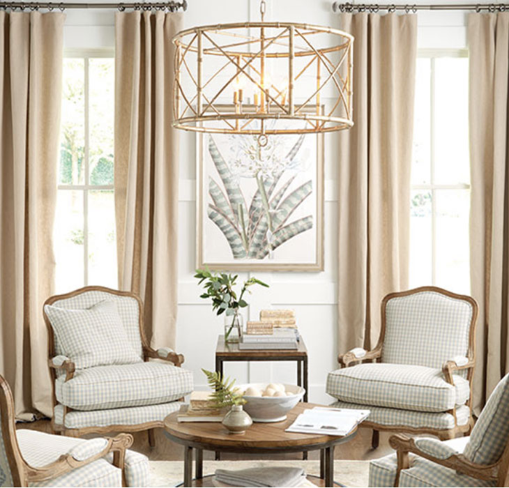 Four bergere armchairs in living room with large gold chandelier | Ballard Designs