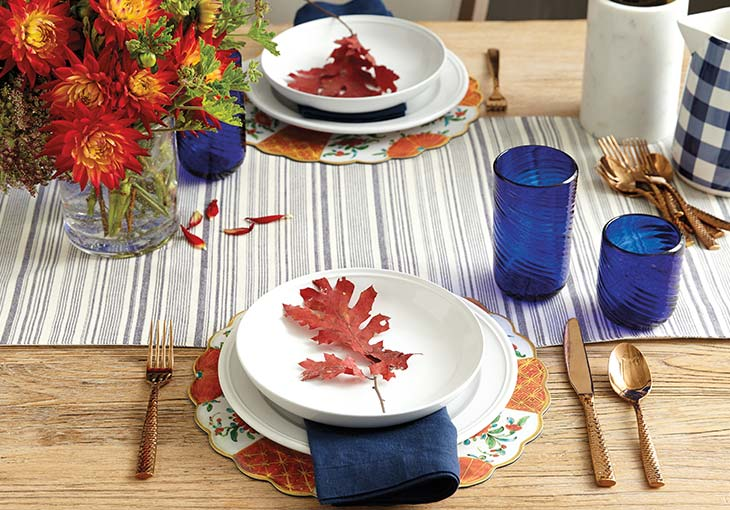 How to set a table with fall-inspired accents like a preserved leaf, striped runner, and blue glassware | Ballard Designs