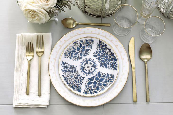 How to set a table for semi-formal occasions with blue and white dinnerware, metallic accents, and small bouquets of roses | Ballard Designs