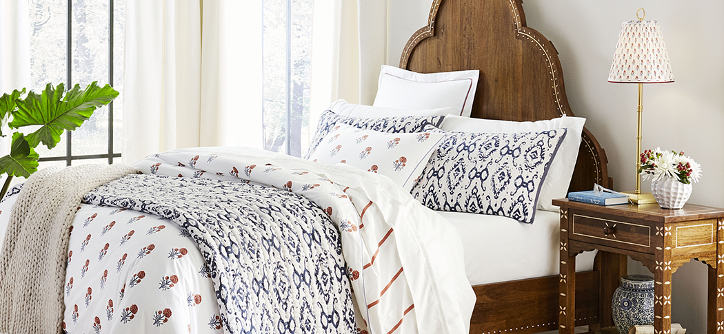 Block print lampshades that match block print bedding in bedroom