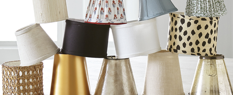 Stacks of lampshades in front of window