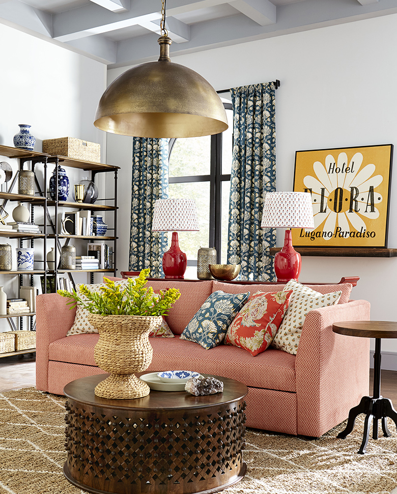 Red table lamps with patterned lampshades in a living room